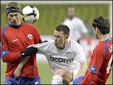 CSKA Moscow duo Aleksei Berezutski (left) and Alan Dzagoev (right) quickly close down Aston Villa's Nicky Shorey (centre)