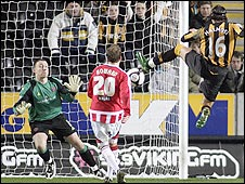 Peter Halmosi turns in a Nick Barmby cross to give Hull a 2-1 win over Sheffield United