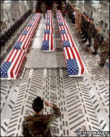 Undated file photo provided by the US Air Force shows flag-draped coffins of US casualties from Iraq being offloaded by a military honor guard from a cargo plane in Dover, Delaware