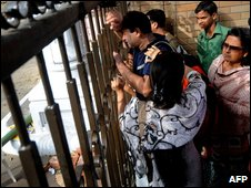 Relatives of a missing officer wait outside the BDR compound in Dhaka on 27/2/09
