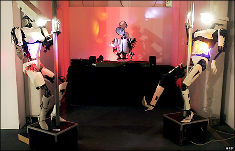 Giles Walker's Peepshow, an installation of pole-dancing robots
