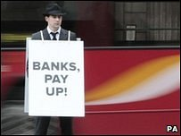 A man wearing a sandwich board protests against bank charges on behalf of Which? on 25 February 2009