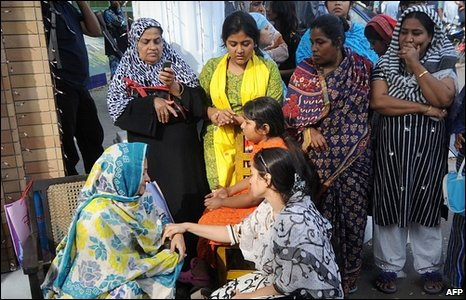 Women wait for news of their missing relatives.