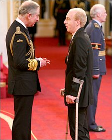 Simon Richardson, receives his MBE from The Prince of Wales at Buckingham Palace