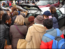 Shoppers crowd round a Mini
