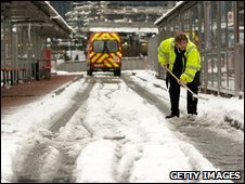 railway worker clears snow at Victoria station on 2 February