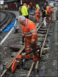 Volunteer Dafydd Thomas laying a final piece of track