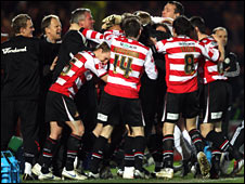 Doncaster celebrate their second goal against Derby