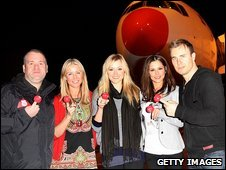 Chris Moyles, Denise Van Outen, Fearne Cotton, Cheryl Cole and Gary Barlow pose before boarding their flight to Tanzania