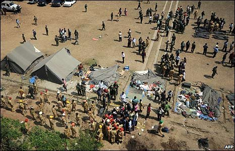 Firefighters and soldiers at the site of a mass grave in Dhaka, Bangladesh
