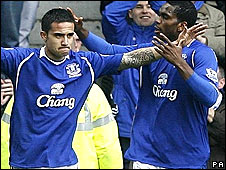 Tim Cahill (left) and Josephy Yobo celebrate