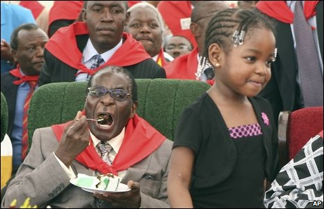 Zimbabwean President Robert Mugabe eats cake at his birthday celebrations