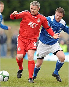 Portadown's Ross Redman on the ball against Paul Donegan of Newry City