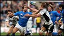 Gonzalo Canale is tackled by Scotland's Thom Evans