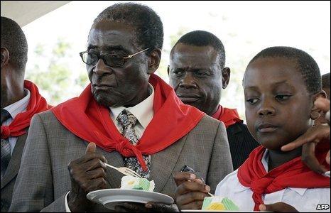 Zimbabwean President Robert Mugabe eats cake at his birthday celebrations