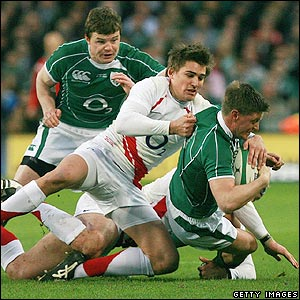 England fly-half Toby Flood wrestles opposite number Ronan O'Gara to the ground
