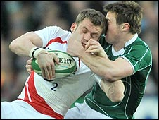 Mark Cueto of England is tackled by Ireland's Tommy Bowe
