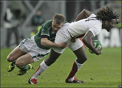 England's Paul Sackey is tackled by Luke Fitzgerald