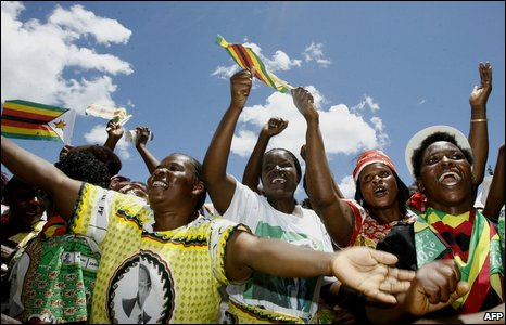 Supporters celebrate at Robert Mugabe's birthday party