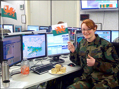 Senior Airman Dana Walker, a meteorologist in the United States Air Force stationed in Belleville, Illinois, celebrated her newly-discovered Welsh heritage with fresh Welsh cakes at the office. Picture from Michael Butrovich.
