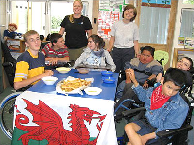 Leek and potato soup and Welsh rarebit on the menu as Room 4 students with their teacher Jess and occupational therapist Pat get in the St David's Day spirit at Kimi Ora Special Needs School, Wellington, New Zealand.