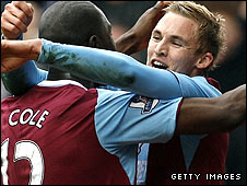Jack Collison (right) celebrates his winner