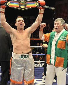 Martin Rogan celebrates his title triumph with trainer John Breen