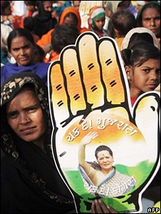 A supporter of Congress party with the party poster containing Sonia Gandhi's picture