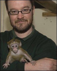 Simon Jeffery and the infant DeBrazza's monkey