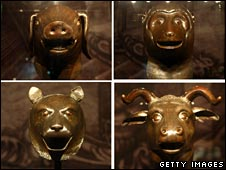 Composite image of four 18th Century Qing dynasty bronze fountainheads: (top L, clockwise) the Pig, the Monkey, the Buffalo and the Tiger, owned by China's Poly Group, on display at a Beijing museum, 19 Feb 2009.