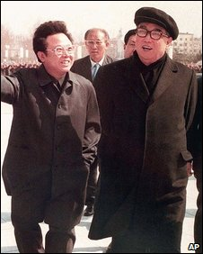 Kim Jong-il, left, walks with father Kim Il-sung in Pyongyang in April 1982
