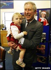 Prince Charles holding Bronwen Giles