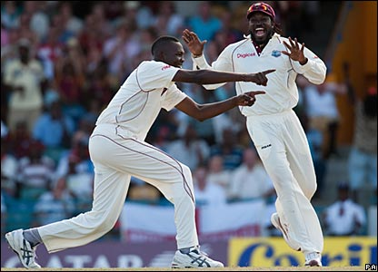 Suliemann Benn and Chris Gayle celebrate Owais Shah's wicket