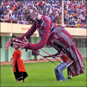 At the opening ceremony, a giant puppet plays with BBC journalist ____