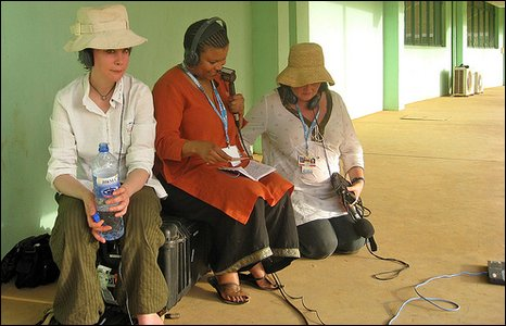 Audrey Brown (centre) talks to the studio in London during a live broadcast of BBC Focus on Africa. Studio Manager, Suzy Robins (left) and producer, Jenny Horrocks monitor the transmission.