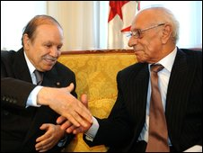 Algerian President Abdelaziz Bouteflika (L) shakes hand with Constitution Council President Boualem Bessayeh (R), in Algiers on 23 February 2009 