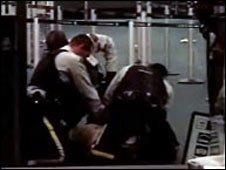 Police restrain Mr Dziekanski. Credit: CBC