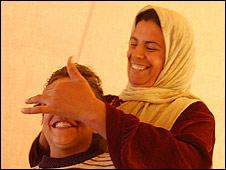 Wafa' Awersha and her son Sobhy, al-Atatra, Gaza