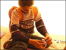 Sobhy Awersha, 11, in tent in al-Atatra, Gaza