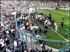 Fans spill on to the pitch during the Hillsborough disaster