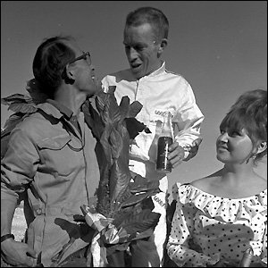 Richie Ginther celebrates winning the 1965 Mexican Grand Prix