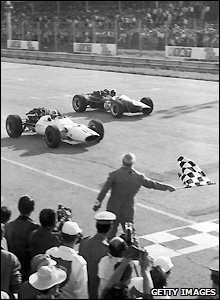 John Surtees (left) beats Jack Brabham to the finish line