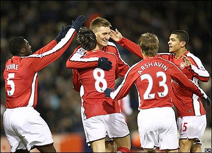 Nicklas Bendtner is congratulated by his Arsenal team-mates