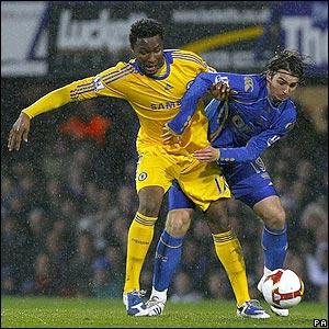 John Obi Mikel battles for possession with Portsmouth midfielder Niko Kranjcar