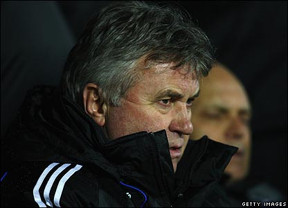 Chelsea manager Guus Hiddink takes shelter in the dugout