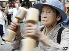 Elderly exercise with wooden dumbbells at a Tokyo temple on Respect-for-the-Aged day, 15 Sep 08