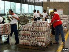 Government inspectors check rice packaging inside the private plant of Polar industries in Calabozo, Venezuela - file photo