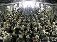 US soldiers inside a plane arrive from Afghanistan at the airbase in Manas