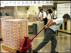 BOJ employee with Japanese money