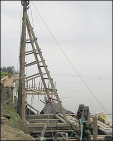 Equipment being put in place to fight erison on the Brahmaputra